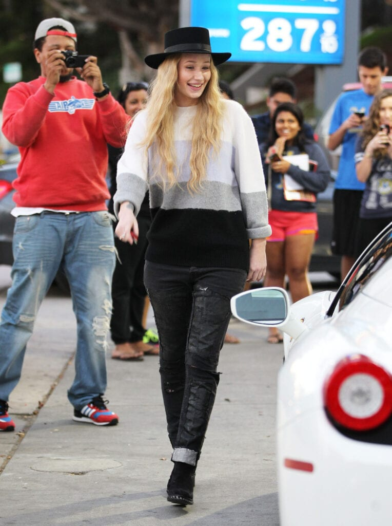 51628401 Australian rapper Iggy Azalea attracts a crowd of fans and photographers while stopping to fill up her white Ferrari in Westwood, California on January 16, 2015. After getting some assistance at the pump from a friendly stranger, Iggy signed autographs and posed for pics with fans. FameFlynet, Inc - Beverly Hills, CA, USA - +1 (818) 307-4813