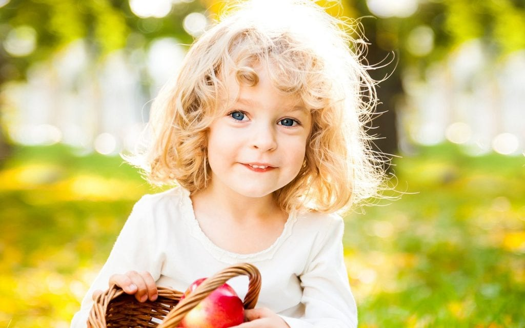 cute smiling children blonde blue eyes apple beautiful #1976049